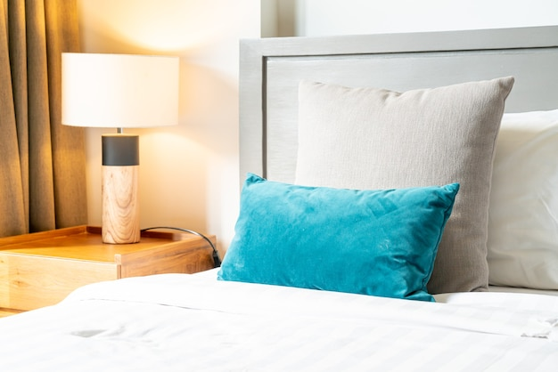 Comfortable pillow decoration on bed in bedroom Premium Photo