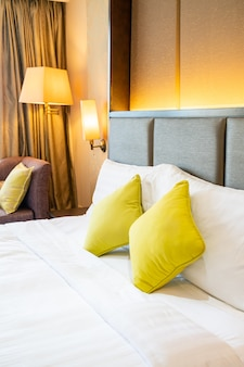 Comfortable pillow decoration on bed in hotel bedroom