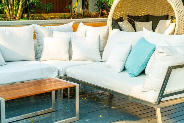 Comfortable pillows on outdoor patio chair and table