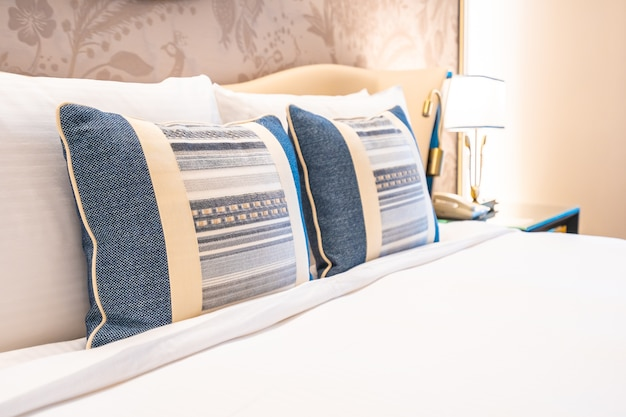 Comfotable pillow on bed with light lamp decoration