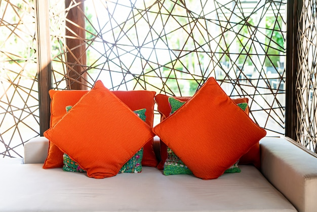 Comfy pillows on outdoor bench