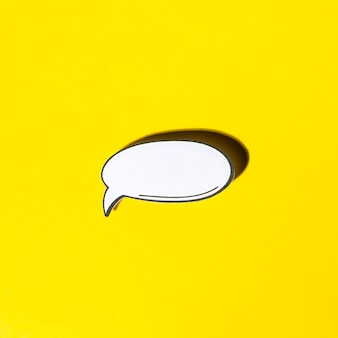Comic empty speech bubble in retro pop art style with shadow on yellow background