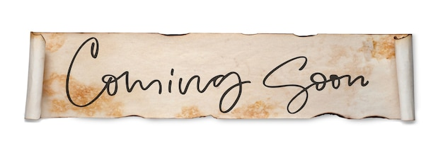 Coming soon. handwritten inscription on a scroll of old paper. isolated on white.