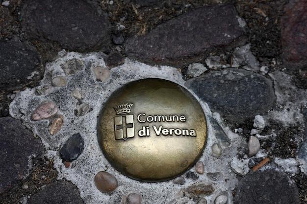 Commemorative badge on the floor in verona