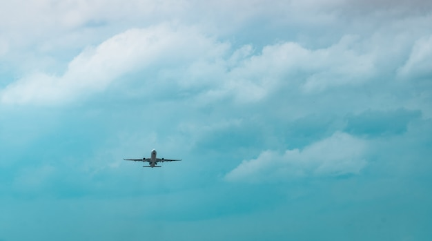 Commercial airline. passenger plane takes off at airport with beautiful blue sky and white clouds. leaving flight. start the abroad journey. vacation time. happy trip.