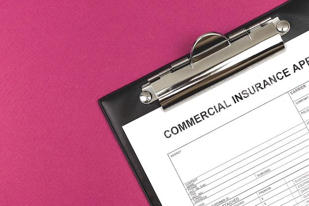 Commercial insurance application. clipboard on a business desktop. top view and copy space photo