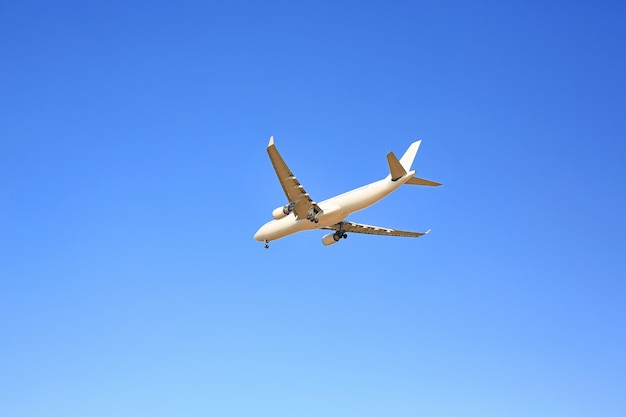 Commercial jet airplane flight on blue sky