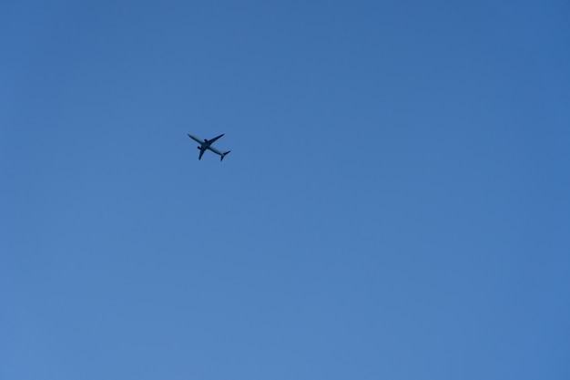 Commercial plane fly on the blue sky