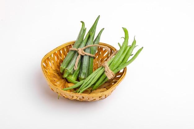 Common bean or dolichos bean pods and okra, farm fresh concept