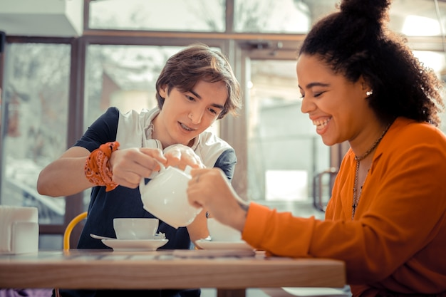 Common time spending. a boy and a girl drinking tea together