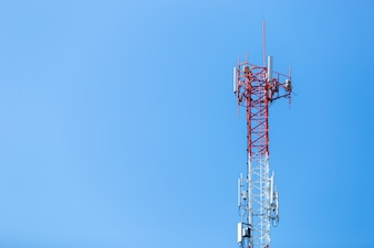 Communication antenna tower with blue sky