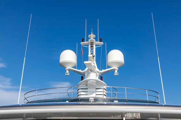 Communication antennas with navigation equipment