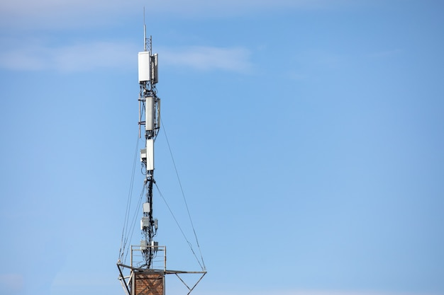 Communication tower top. radio antenna tower , microwave antenna tower on light sky background