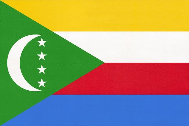 コモレ島の国家布旗、繊維の背景。国際世界のアフリカの国のシンボル。