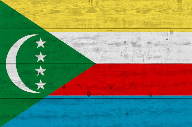 Comoros flag painted on old wood plank