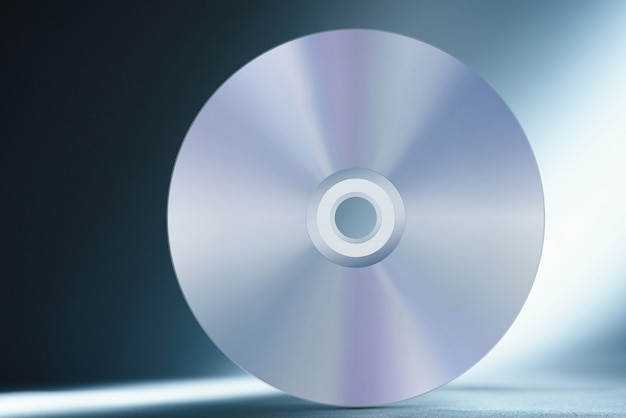 Compact disc on abstract blue
