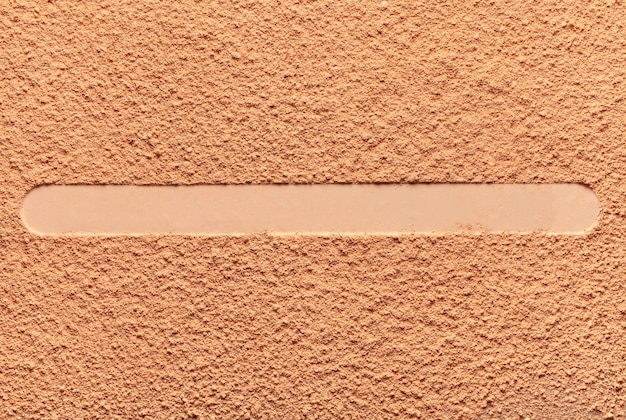 Compact pressed beige powder