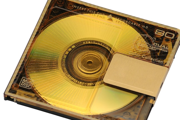 Compact rewritable mini disc- md for digital recording released in the 90s on an isolated white.