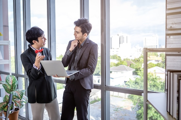 Company executive young asian businessman and coaching personal secretary assistant homosexual businessman lgbt  partners while working together with laptop computer and strategy in business in office