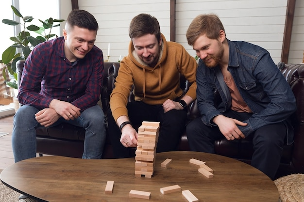 The company of guys plays board games, teamwork. high quality photo