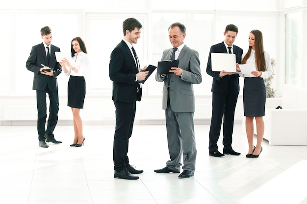 Company's employees are preparing to start a business meeting.
