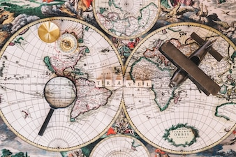 Compass and magnifying glass near writing