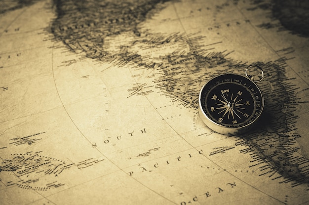 Compass on antique map. - vintage style