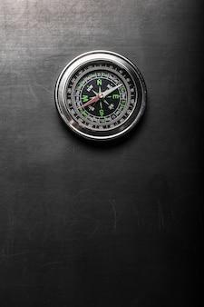Compass on black board