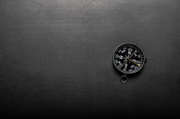 Compass on blackboard background