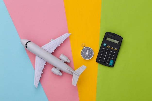 Compass, calculator and air plane. cost of travel,
