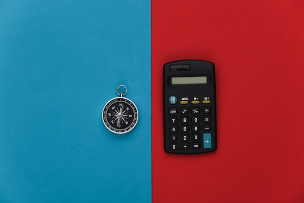 Compass and calculator on a red-blue
