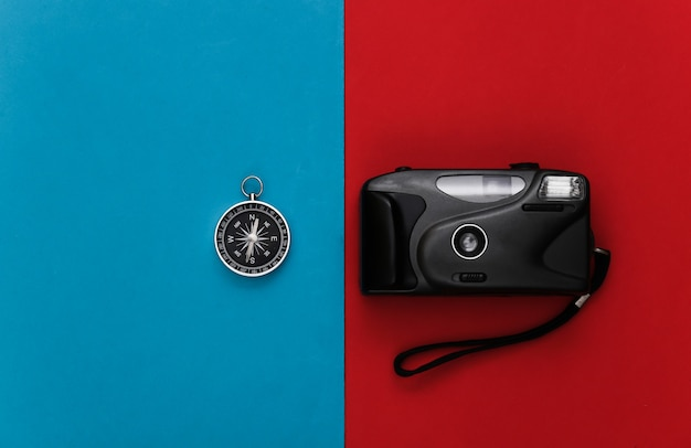 Compass and camera on a red-blue