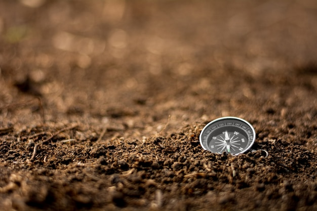 Compass on cracked soil. travel and transportation concept.