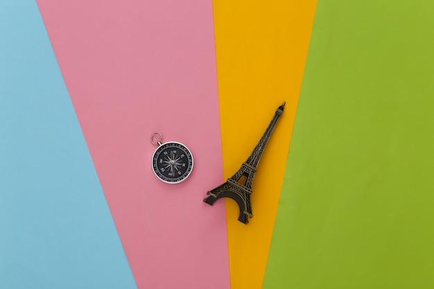 Compass and eiffel tower figurine