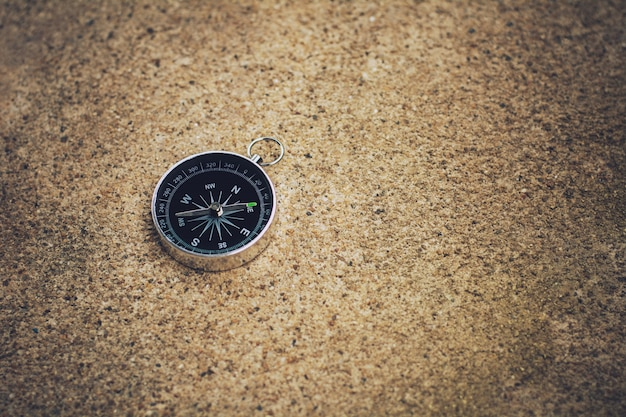 Compass on the floor. - background