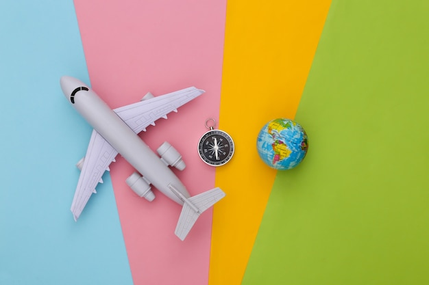 Compass, globe and air plane