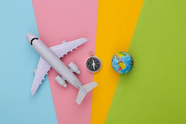나침반, 지구본 및 비행기