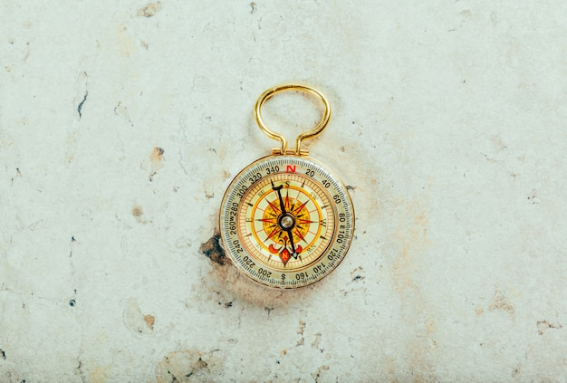 Compass on a gray gradient background
