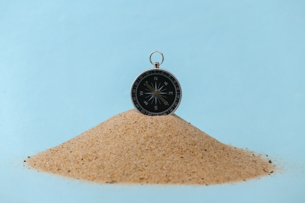 Compass on an islet of sand. travel, adventure concept