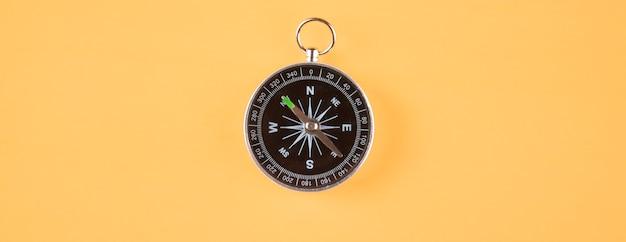 Compass on isolated orange scene