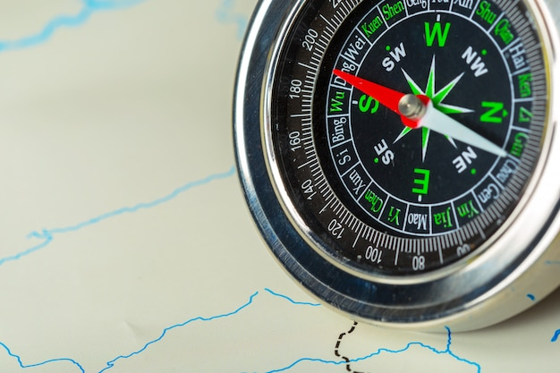 Compass on map background travel
