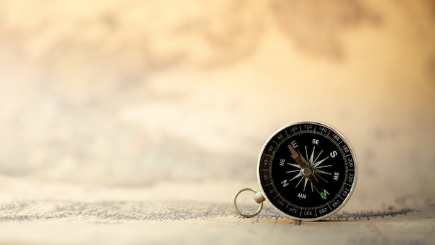Compass on the old map. travel and transportation concept.