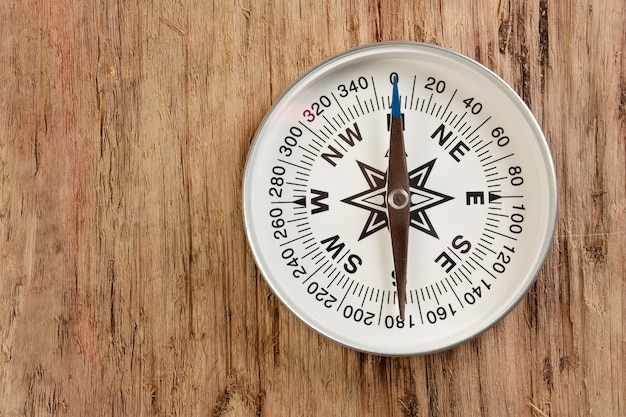 Compass on old wooden space