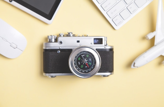 Compass and other objects on the yellow background. travel