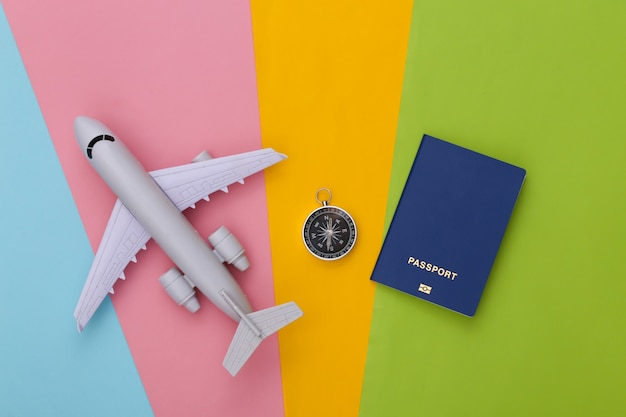 Compass, passport and air plane