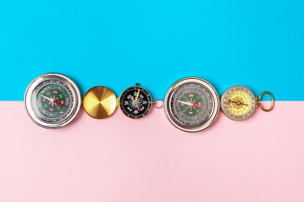 Compass on pink and blue, top view