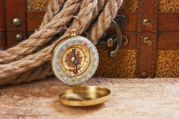 Compass rope and wooden chest, still life
