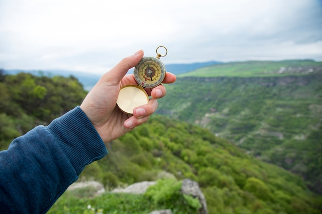 Compass on the scene of a green cliff
