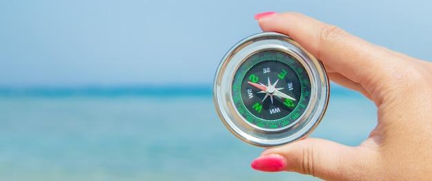 Compass on the sea coast.