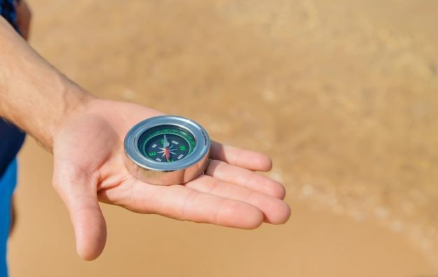 Compass on the sea coast
